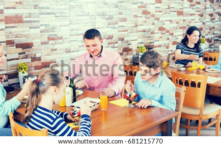 Smiling family having lunch in cozy cafe