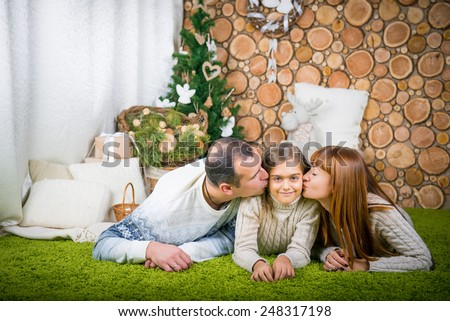 Smiling family home evening.  winter evening together at home. promote family values. family home evening, mom, dad and daughter - stock photo