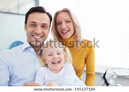 Smiling family in a dental clinic - stock photo