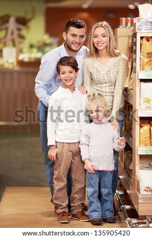 Smiling family in a store - stock photo