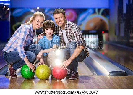 Smiling family in biwling club