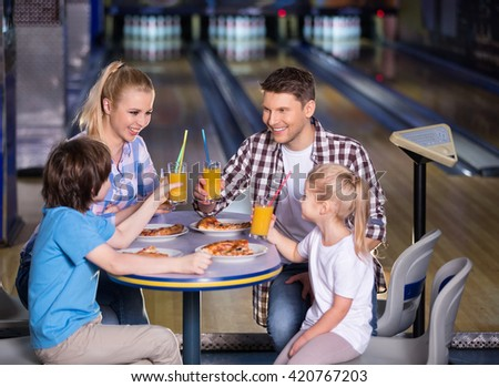 Smiling family in bowling cafe