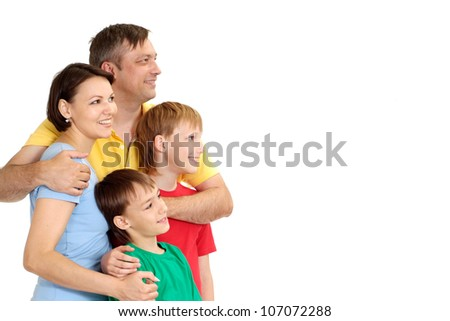 Smiling family in bright T-shirts on a white background