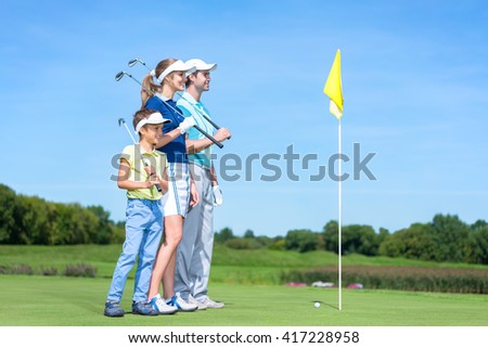 Smiling family in golf course
