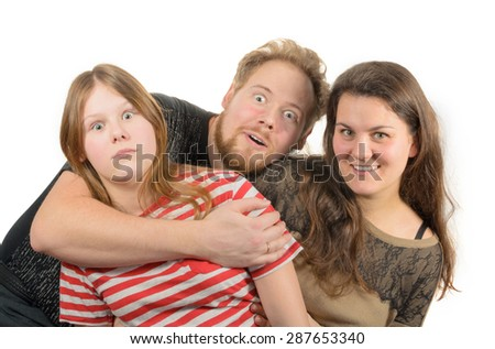 smiling family of mother, father and daughter - stock photo