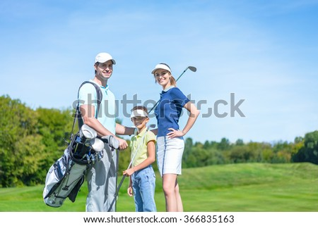 Smiling family on the golf course