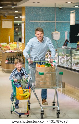 Smiling family with cart