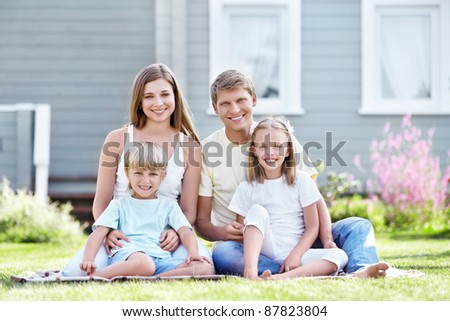 Smiling family with children in the garden