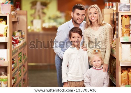 Smiling family with children in the store