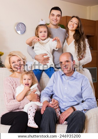 smiling family with grand children at home - stock photo