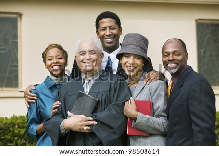 Smiling Family with Preacher - stock photo