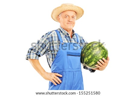 Smiling farmer holding a watermelon isolated on white background