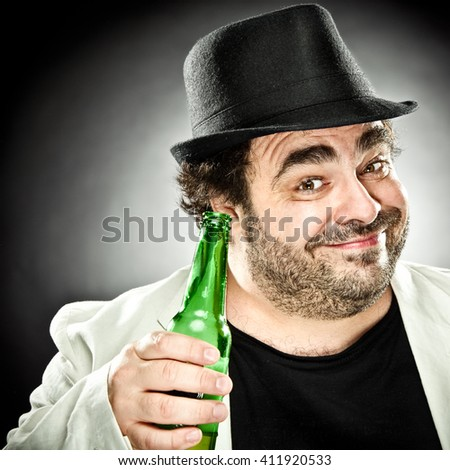 smiling fat beard man portrait drink a beer on grey background