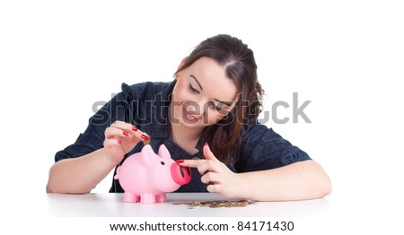 smiling fat young woman with pink piggy bank - stock photo