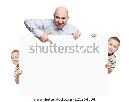 Smiling father and little sons holding blank sign or placard white isolated