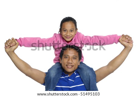 Smiling father carrying on his shoulders his little daughter