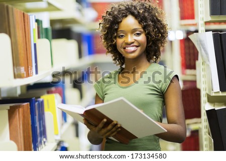 smiling female african american student in university library - stock photo