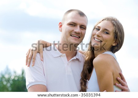 Smiling female and her husband embracing each other