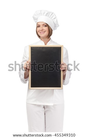 smiling female chef, cook or baker holding blackboard isolated on white background. advertisement or menu blank board. your text here