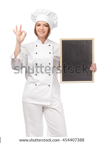 smiling female chef, cook or baker with blackboard showing an okay sign isolated on white background. proposing restaurant menu. advertisement gesture