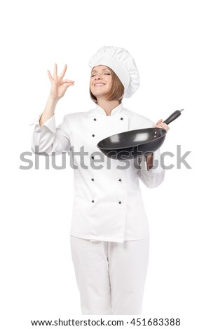 smiling female chef, cook or baker with frying pan making tasty gesture and enjoying food isolated on white background. food, restaurant and cooking concept