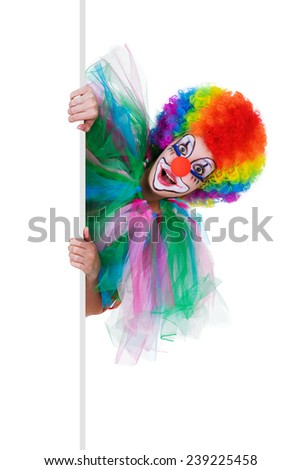 smiling female clown posing behind a blank panel isolated on white background - stock photo
