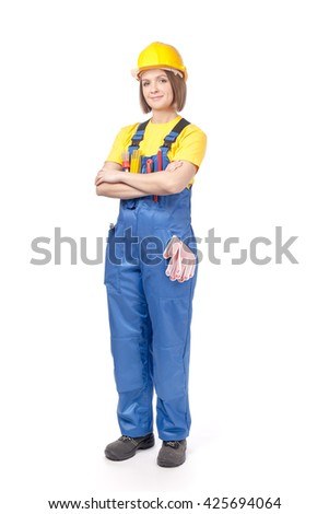 smiling female construction worker or decorator in yellow hardhat and workwear isolated on white background - stock photo