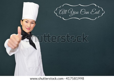 Smiling female cook gesturing thumbs up in kitchen against all you can eat message