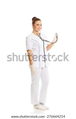 Smiling female doctor holding a stethoscope. - stock photo