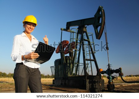 Smiling Female Engineer in an Oilfield - stock photo