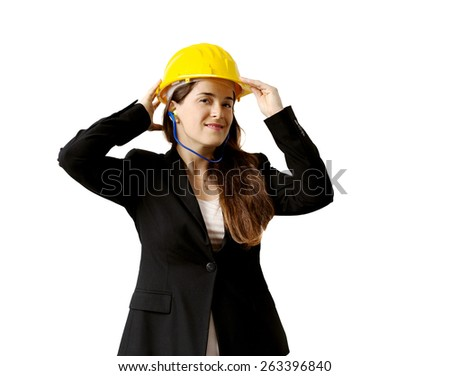 smiling female engineer with safety helmet and earplugs over white background
