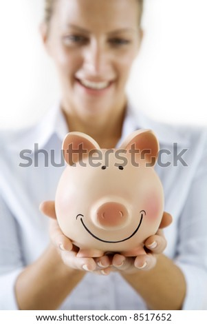 smiling female holding piggy-bank