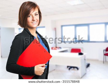 Smiling female manager in the office - stock photo