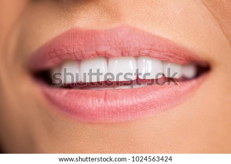 Smiling female mouth with healthy white teeth