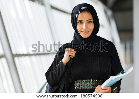 smiling female muslim university student - stock photo