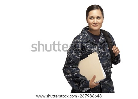 Smiling female navy sailor with shoulder bag and books - stock photo