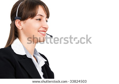 Smiling female operator with headset is isolated against white background - stock photo