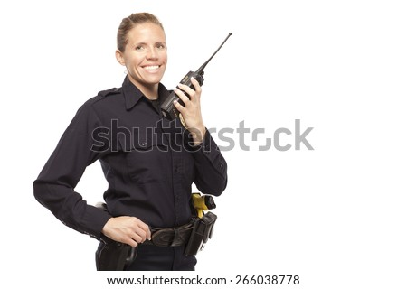 Smiling female police officer talking on a radio against white background - stock photo