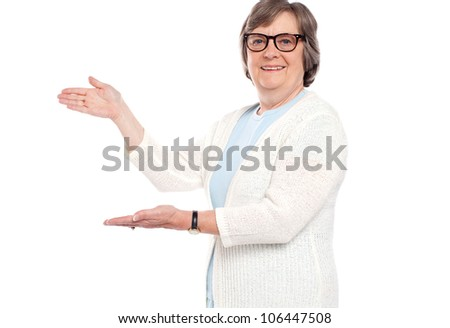 Smiling female presenting copy space against white background - stock photo