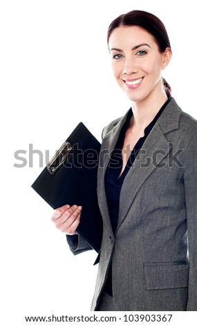 Smiling female secretary holding clipboard. All on white background