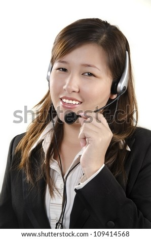 Smiling female service agent with headset - stock photo
