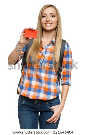Smiling female student holding empty credit card, over white background - stock photo