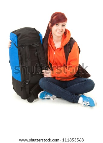 smiling female tourist with backpack, full length, white background - stock photo