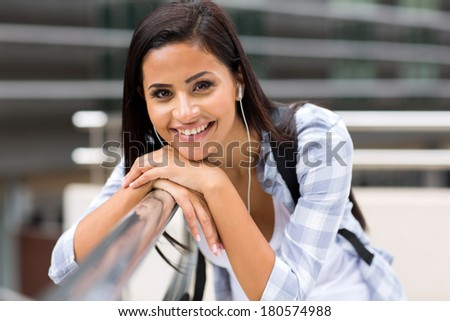 smiling female university student on campus - stock photo