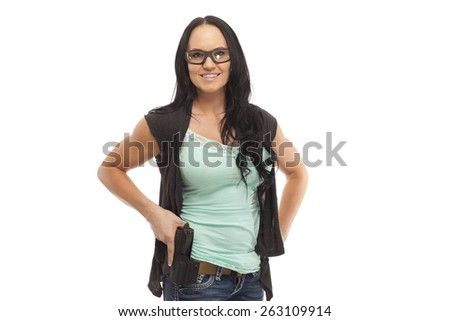 Smiling female with handgun against white background - stock photo