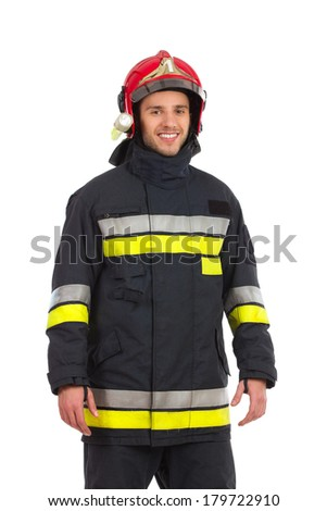 Smiling firefighter posing, Front view. Three quarter length studio shot isolated on white. - stock photo