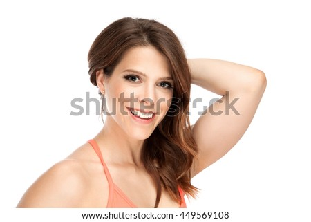 Smiling fit young and attractive woman in studio - stock photo