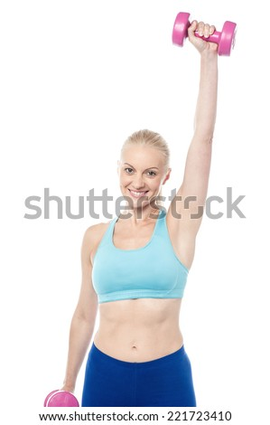 Smiling fitness woman hands with pink dumbbells - stock photo