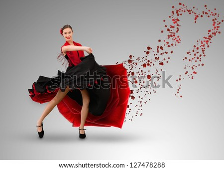 Smiling flamenco dancer with heart shaped paint splatter coming from dress on grey background - stock photo