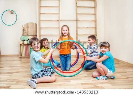 Smiling friends in a school gym - stock photo